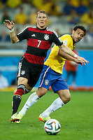 Fred of Brazil and Bastian Schweinsteiger of Germany