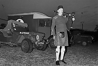 - Normandy, war veterans and collectors of vintage military vehicles participate the yearly ceremonies for the commemoration of the allied landing of June 1944, Scottish bagpiper....- Normandia, veterani di guerra e collezionisti di veicoli militari d'epoca partecipano alle annuali cerimonie per la commemorazione degli sbarchi alleati del giugno 1944, suonatore di cornamusa scozzese