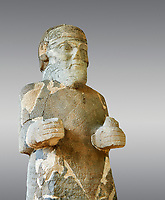 Pictures & images of the South Gate Hittite sculpture statue of Hittite Storm God Tarhunzas ( Tarḫunz Tarḫunna or in Hurrian Teshub or in Phoenician Baal Krntrys ). 8th century BC. Karatepe Aslantas Open-Air Museum (Karatepe-Aslantaş Açık Hava Müzesi), Osmaniye Province, Turkey.  Against grey background