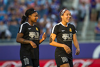 Orlando, Florida - Sunday, May 14, 2016: Western New York Flash forward Taylor Smith (11) and defender Jaelene Hinkle (15) have a laugh during warm-ups of a National Women's Soccer League match between Orlando Pride and New York Flash at Camping World Stadium.