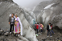 Tourists visiting the Hailuogou glacier in western Sichuan Province, China. As a result of rising temperatures on the Tibetan Plateau, the Hailuogou glacier has retreated over 2 km during the 20th century alone. Since the Little Ice Age, studies have revealed that the total monsoonal glacier coverage in the southeast of the Tibetan Plateau has decreased by as much as 30 percent, causing alarm in scientific circles.