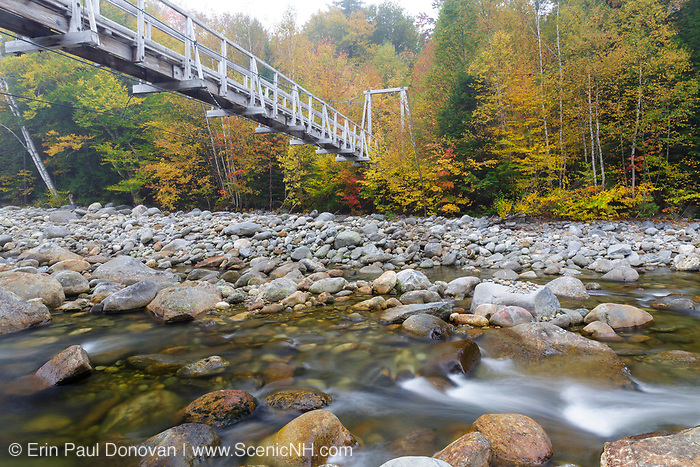Foot bridge, which crosses the Peabody River at the start of the Great Gulf Trail in Green's Grant in the New Hampshire White Mountains on a foggy autumn morning.