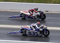 Apr. 28, 2013; Baytown, TX, USA: NHRA pro stock motorcycle rider Hector Arana Jr (near lane) races alongside Hector Arana Sr during the Spring Nationals at Royal Purple Raceway. Mandatory Credit: Mark J. Rebilas-