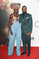 """Lupita Nyong'o and David Oyelowo<br /> at the London Film Festival 2016 premiere of """"Queen of Katwe"""" at the Odeon Leicester Square, London.<br /> <br /> <br /> ©Ash Knotek  D3168  09/10/2016"""