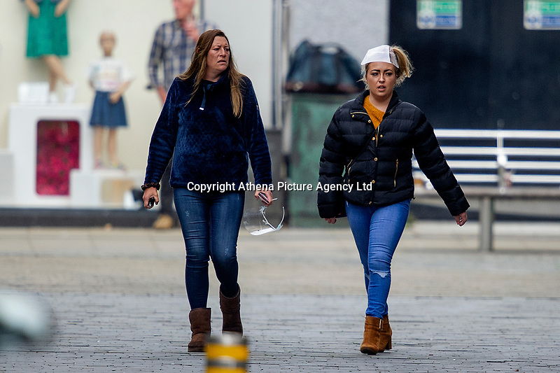 Pictured: Two ladies walk down St Mary's Square, Swansea city centre, Wales, UK. Monday 28 September 2020<br /> Re: Local lockdown will be in force from 6pm on the 27th September 2020 due to the Covid-19 Coronavirus pandemic, in Swansea, Wales, UK.