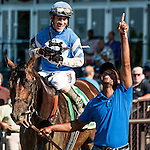 July 4, 2015 : Effinex (blue cap), ridden Junior Alvarado, outdoes Tonalist, ridden by John Velazquez, to win the Suburban Handicap on Stars and Stripes Day at belmont Park in Elmont, New York.