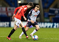 Bolton Wanderers' Tom White (right) competing with Salford City's Luke Burgess<br /> <br /> Photographer Andrew Kearns/CameraSport<br /> <br /> The EFL Sky Bet League Two - Bolton Wanderers v Salford City - Friday 13th November 2020 - University of Bolton Stadium - Bolton<br /> <br /> World Copyright © 2020 CameraSport. All rights reserved. 43 Linden Ave. Countesthorpe. Leicester. England. LE8 5PG - Tel: +44 (0) 116 277 4147 - admin@camerasport.com - www.camerasport.com