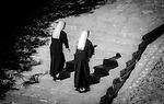 Two nuns ascending steps in the town of Herceg Novi in Montenegro