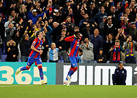 27th September 2021;  Selhurst Park, Crystal Palace, London, England; Premier League football, Crystal Palace versus Brighton & Hove Albion: Wilfried Zaha of Crystal Palace celebrates with Conor Gallagher  after scoring his sides 1st  from a penalty kick in the 45th minute to make it 1-0