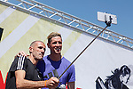 Runner Chema Martinez (L) and Atletico´s player Fernando Torres take a selfie photography during Adidas presentation in Madrid, Spain. April 20, 2015. (ALTERPHOTOS/Victor Blanco)