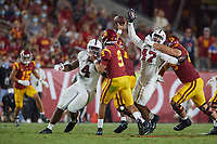 LOS ANGELES, CA - SEPTEMBER 11: Tangaloa Kaufusi #47 and Thomas Booker #4 of the Stanford Cardinal pressure Kedon Slovis #9 of the USC Trojans during a game between University of Southern California and Stanford Football at Los Angeles Memorial Coliseum on September 11, 2021 in Los Angeles, California.
