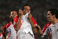 Costa Rica's Marcos Urena (7) kisses his jersey as he celebrates the winning goal against Egypt with teammates, Jorge Castro (9), left, and  Diego Madrigal (11), right, during the FIFA Under 20 World Cup Round of 16 match between Egypt and Costa Rica at the Cairo International Stadium on October 06, 2009 in Cairo, Egypt.