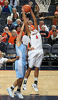 CHARLOTTESVILLE, VA- JANUARY 5: Simone Egwu #4 of the Virginia Cavaliers grabs a rebound next to Krista Gross #21 of the North Carolina Tar Heels during the game on January 5, 2012 at the John Paul Jones arena in Charlottesville, Virginia. North Carolina defeated Virginia 78-73. (Photo by Andrew Shurtleff/Getty Images) *** Local Caption *** Krista Gross;Simone Egwu
