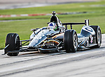 Ryan Briscoe (2) driver of the Hitachi Team Penske car in action during the IZOD Indycar Firestone 550 race at Texas Motor Speedway in Fort Worth,Texas. Justin Wilson (18) driver of the Sonny's BBQ car wins the Firestone 550 race...