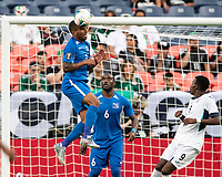 DENVER, CO - JUNE 19: Joris Marveaux #3 heads the ball out from in front of the goal during a game between Martinique and Cuba at Broncos Stadium on June 19, 2019 in Denver, Colorado.