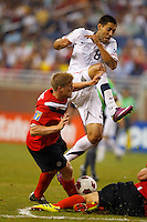 7 June 2011: USA Men's National Team forward Clint Dempsey (8) and Canada defender Marcal De Jong (19) go for the ball in the first half during the CONCACAFsoccer match between USA MNT and Canada MNT at Ford Field Detroit, Michigan.