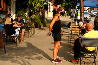 Alexa Namestnik waits on tables outside of Lot 17 in the Bloomfield neighborhood on Tuesday July 21, 2020 in Pittsburgh, Pennsylvania. (Photo by Jared Wickerham/Pittsburgh City Paper)