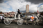 """© Joel Goodman - 07973 332324 . 28/08/2015 . Salford , UK . The procession passes along Heywood Way  . The funeral of Paul Massey at St Paul's CE Church in Salford . Massey , known as Salford's """" Mr Big """" , was shot dead at his home in Salford last month . Photo credit : Joel Goodman"""