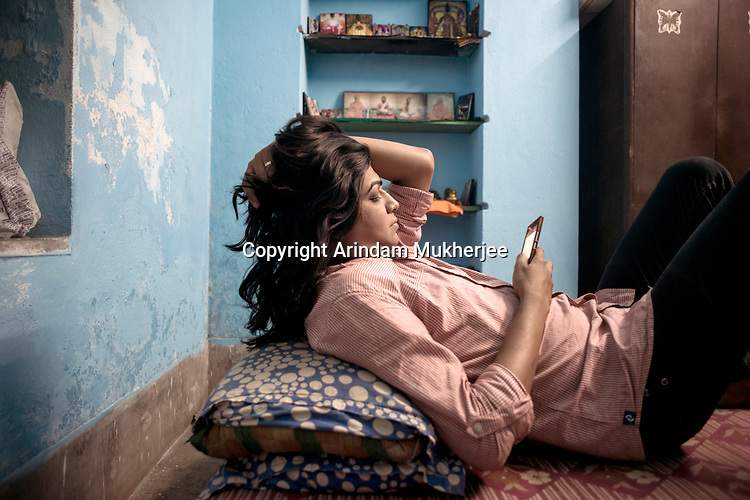 Dipmalya(Diya) mantains her business of garment designing with the help of his smart phone.  He does not  have a computer at home. Free phone data helps him to do business through internet. Kolkata, India. Arindam Mukherjee