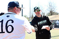 CARY, NC - FEBRUARY 23: Head coach Jim Carone of Wagner College shakes hands with head coach Rob Cooper of Penn State University during a game between Wagner and Penn State at Coleman Field at USA Baseball National Training Complex on February 23, 2020 in Cary, North Carolina.