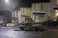 """Pictured: The burned out cars in Waun-Wen Road in the Mayhill area of Swansea, Wales, UK. Thursday 20 May 2021<br /> Re: Gangs of """"yobs"""" have been setting fire to cars and rolling them down a hill in Swansea, Wales, UK.<br /> South Wales Police said they attended """"large scale disorder"""" in the Mayhill area of the city on Thursday evening."""