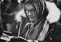 A cree woman follows the service in her prayerbook in the Anglican Church at Fort George, qc.<br /> <br /> 1974<br /> <br /> PHOTO :  Bob Olsen - Toronto Star Archives - AQP