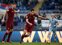 Calcio, Serie A: Lazio vs Roma. Roma, stadio Olimpico, 4 dicembre 2016.<br /> Roma's Kevin Strootman, right, flanked by his teammate Edin Dzeko, prepares to kick to score during the Italian Serie A football match between Lazio and Rome at Rome's Olympic stadium, 4 December 2016. Roma won 2-0.<br /> UPDATE IMAGES PRESS/Isabella Bonotto