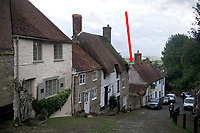 BNPS.co.uk (01202 558833)<br /> Pic: ZacharyCulpin/BNPS<br /> <br /> A cottage on the iconic 'Hovis Hill' is going up for auction for £150,000.<br /> <br /> The Grade II listed building is on Gold Hill in Shaftesbury, Dorset, made famous by Ridley Scott's 'Boy on Bike' television advert for Hovis bread.<br /> <br /> Number 16 Gold Hill is halfway up the hill and is in need of complete renovation, although work to extend and refurbish the property have been partly completed.<br /> <br /> Auctioneers Symonds & Sampson say once completed the cottage would make an ideal home, second home or holiday let.<br /> <br /> Gold Hill was immortalised in the 1973 Hovis ad which saw a young bakery boy struggling to push his bike up the cobbled street with a basket full of bread to the last house on his round.