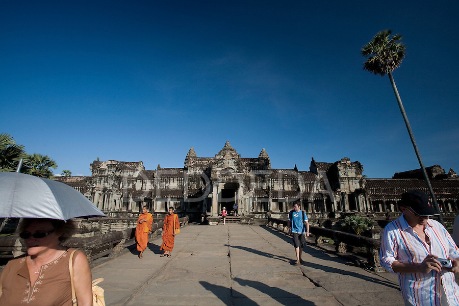 Tourists visit the ancient city and temples of Angkor Wat, in northwestern Cambodia, where Khmer kings established their capitals from the ninth to the twelfth century.