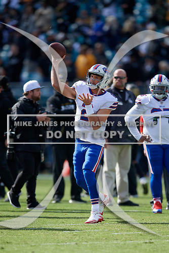 Buffalo Bills quarterback Nathan Peterman (2) passes during warmups before an NFL Wild-Card football game against the Jacksonville Jaguars, Sunday, January 7, 2018, in Jacksonville, Fla.  (Mike Janes Photography)