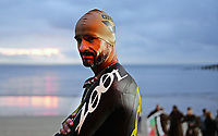 Pictured: One of the Ironman athletes before taking to the sea in Tenby Pembrokeshire, Wales, UK. Sunday 10 September 2017<br /> Re: The Ironman Wales triathlon has returned to Pembrokeshire for a sixth time.<br /> More than 2,000 endurance athletes are taking on one of the most challenging courses in the sport, starting and finishing in Tenby.<br /> It includes a 2.4 mile (or 3.8km) swim, a 112 mile (or 180km) bike ride and 26.2 mile (or 42km) run within 17 hours.