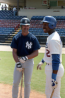 New York Yankees Don Mattingly and Los Angeles Dodgers Willie Randolph (12) during spring training circa 1989 at Holman Stadium in Vero Beach, Florida.  (MJA/Four Seam Images)