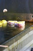 Gruissan village. La Clape. Languedoc. Restaurant La Cranquette. Tuna fish fried grilled. With potatoes. France. Europe.