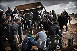 © Remi OCHLIK/IP3 -   Benghazi  March 20, 2011 - Funerals in the cimetery of Benghazi..Libyan men morn the dead in the morgue of the Benghazi hospital - At least 84 people, most of them are civilians , and had been killed in the Ghadafi air strike the day before.