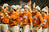 Erich Weiss #6 celebrates with his teammates after defeating the Rice Owls at Minute Maid Park on March 2, 2012 in Houston, Texas.  The Longhorns defeated the Owls 11-8.  Brian Westerholt / Four Seam Images
