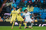 Marcelo Vieira Da Silva (R) of Real Madrid fights for the ball with Rodrigo Hernandez Cascante, Rodri (C), of Villarreal CF during the La Liga 2017-18 match between Real Madrid and Villarreal CF at Santiago Bernabeu Stadium on January 13 2018 in Madrid, Spain. Photo by Diego Gonzalez / Power Sport Images