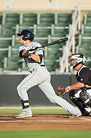 Creede Simpson (18) of the Delmarva Shorebirds follows through on his swing against the Kannapolis Intimidators at CMC-NorthEast Stadium on July 1, 2014 in Kannapolis, North Carolina.  The Intimidators defeated the Shorebirds 5-2. (Brian Westerholt/Four Seam Images)
