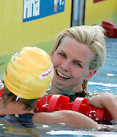 Germany's Britta Steffen is congratulated by Australia's Libby Trickett, left, after winning the gold medal in the Women's 100m Freestyle final at the Swimming World Championships in Rome, 31 July 2009..UPDATE IMAGES PRESS/Riccardo De Luca