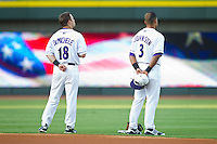 Joey DeMichele (18) and Micah Johnson (3) of the Winston-Salem Dash during the National Anthem prior to the game against the Salem Red Sox at BB&T Ballpark on August 15, 2013 in Winston-Salem, North Carolina.  The Red Sox defeated the Dash 2-1.  (Brian Westerholt/Four Seam Images)