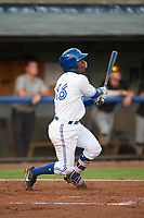 Bluefield Blue Jays second baseman Jose Theran (16) follows through on a swing during the second game of a doubleheader against the Bristol Pirates on July 25, 2018 at Bowen Field in Bluefield, Virginia.  Bristol defeated Bluefield 5-2.  (Mike Janes/Four Seam Images)