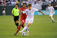 Robbie Rogers (7) of the United States (USA) is defended by Gabriel Gomez (6) of Panama (PAN). The United States (USA) defeated Panama (PAN) 2-1 during a quarterfinal match of the CONCACAF Gold Cup at Lincoln Financial Field in Philadelphia, PA, on July 18, 2009.