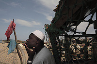 Guy in white skull cap with goat in background is Fall Htikh +221 522 7417..Woman in beach settlement with red and yellow cloth on her head is: Marerme Dieng..Industrialized fishermen pay a license to fish, but then there is no limit for how much they can catch.  The artesenal fishermen are not regulated in any way.  The govt is realizing they have to have some control and banned fishing in November and are opening 5 MPA's...600,000 Senegalese participate in the fishing industry.  When you multiply that number times the 6 or 7 kids they each have and other dependents, you can see that this is a significant percentage of the 12 million Senegalese.  Eighty percent of the fish caught are caught by artesinal fishermen.