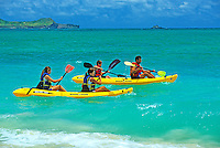 Family kayaking offshore at Kailua Beach on the windward side of the island of Oahu.