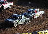 Dec. 10, 2011; Chandler, AZ, USA;  LOORRS pro lite unlimited driver Casey Currie leads Chris Brandt during round 15 at Firebird International Raceway. Mandatory Credit: Mark J. Rebilas-
