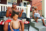 Crystal Foster straightens and combs Gavin Bressler's hair before celebrating a birthday with a pool party at 16th and Boas. JUSTIN A. SHAW/The Patriot-News