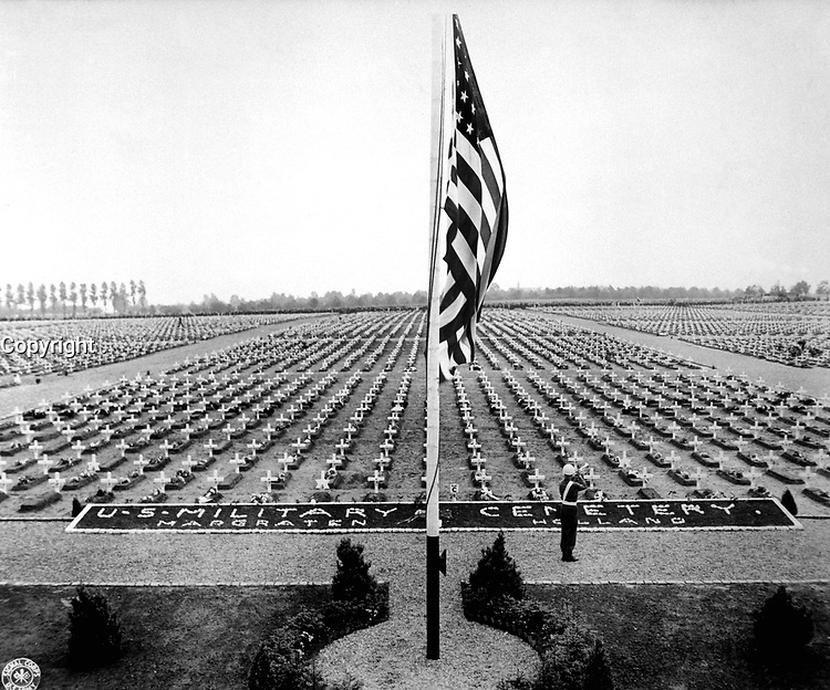 A bugler blow taps at the close of Memorial Day service at Margraten Cemetery, Holland, where lie thousands of American heroes of World War II.  May 30, 1945.  Pfc. Richard G. Thompson.  (Army)<br /> NARA FILE #:  111-SC-207902<br /> WAR & CONFLICT BOOK #:  1348