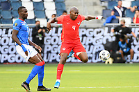 KANSAS CITY, KS - JULY 15: Kamal Miller #4 of Canada with the ball during a game between Canada and Haiti at Children's Mercy Park on July 15, 2021 in Kansas City, Kansas.