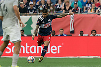 FOXBOROUGH, MA - JULY 25: Gustavo Bou #7 of New England Revolution scores during a game between CF Montreal and New England Revolution at Gillette Stadium on July 25, 2021 in Foxborough, Massachusetts.