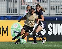 FC Gold Pride midfielder Adriane (21) against Washington Freedom defender Jill Gilbeau (3).   Washington Freedom defeated FC Gold Pride 3-1at the Maryland SoccerPlex, Sunday May 31, 2009.