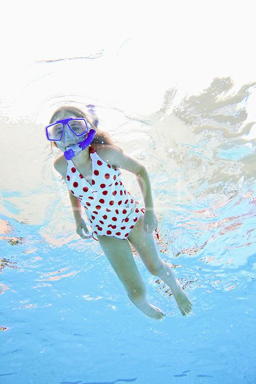 USA, Florida, St. Petersburg, Girl (10-11) diving in swimming pool